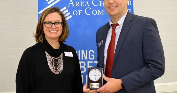 Photography of Iowa City Area Chamber of Commerce 2018 Ambassador of the Year William Easton and Jennifer Banta